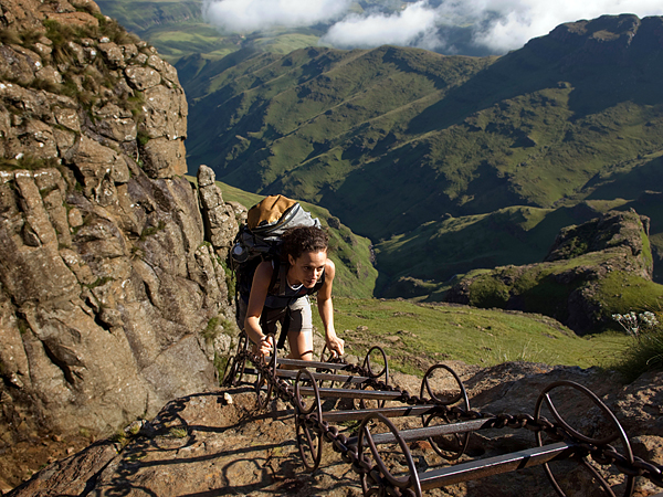 AWNANP hiker climbing a chain ladder leading to the top of the amphitheatre, Drakensberg Mountain, South Africa