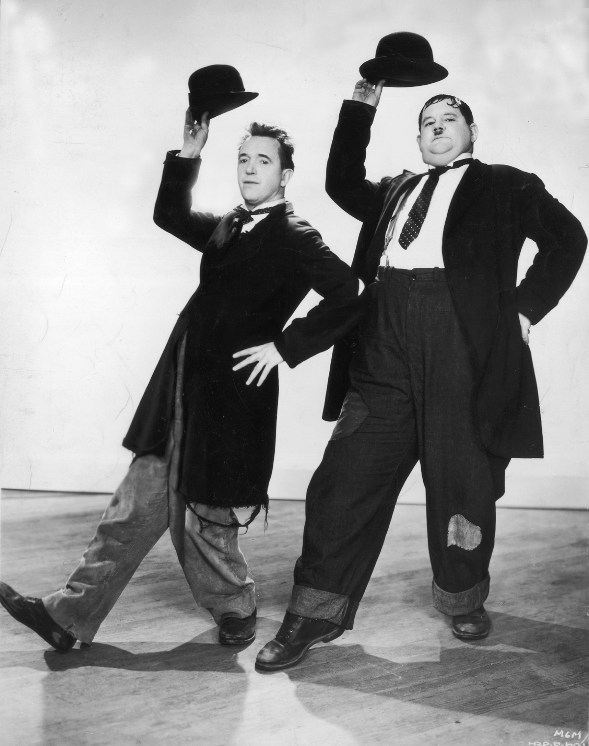 Stan Laurel (1890 - 1965) and Oliver Hardy (1892 - 1957) in a dance routine from the film 'Way Out West', directed by James Horne.   (Photo by Hulton Archive/Getty Images)